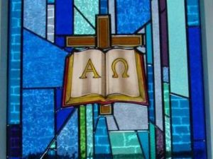 14. God's Word — Symbol: Cross with the Holy Bible and the Christ Monogram, Alpha and omega are the first and last letters of the Greek alphabet. This couple of letters when combined with the Cross, is a Chi Rho symbol. Corner: Scroll