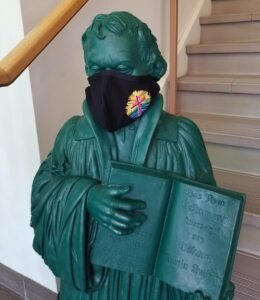 Martin Luther Statue with logo mask